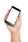 拿着大智能手机的手 免版税库存照片