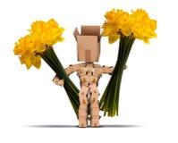 拿着大束黄水仙的Boxman 免版税库存照片
