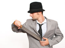 拿着大砍刀的新生意人 免版税库存照片