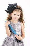 拿着大蜡笔的美丽的小女孩 免版税库存图片