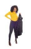 拿着她的外套的非裔美国人的妇女毛线衣 库存图片