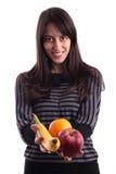 拿着妇女的果子新 库存图片