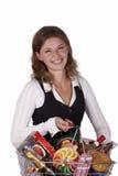 拿着妇女的袋子副食品 库存图片