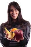 拿着妇女的fruites新 免版税图库摄影