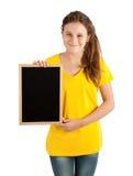 拿着委员会的女孩 免版税库存图片