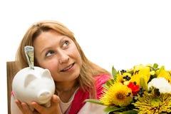 拿着存钱罐的可爱的女性 库存图片
