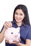 拿着存钱罐的微笑的妇女 图库摄影