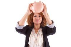 拿着存钱罐- Afr的年轻非裔美国人的女商人 库存图片