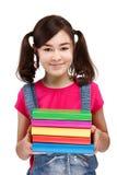 拿着学员的书 免版税库存照片