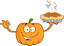 拿着完善的饼的微笑的南瓜漫画人物 库存照片