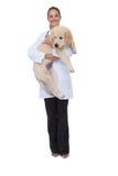 拿着小狗的微笑的狩医 库存图片