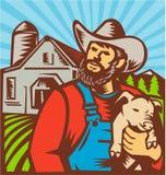 拿着小猪谷仓的养猪户减速火箭 免版税图库摄影