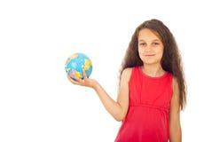 拿着小的世界的女孩地球 库存图片