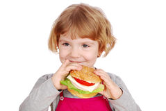 拿着少许三明治的女孩 免版税图库摄影