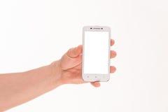拿着巧妙的电话的人的手 免版税库存图片