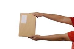 拿着布朗包裹箱子 图库摄影