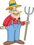 拿着干草叉的动画片农夫 免版税库存照片