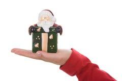 拿着当前圣诞老人小的妇女的配件箱圣诞节 库存照片