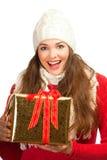 拿着当前妇女的美好的圣诞节 库存图片