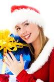 拿着当前妇女的美好的圣诞节 免版税图库摄影