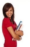 拿着微笑的学员的书 免版税图库摄影