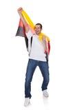 拿着德国标志的一个愉快的人的纵向 免版税库存图片