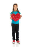 拿着心脏枕头的女孩 图库摄影