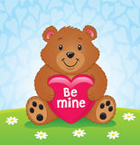 拿着心脏的情人节熊 库存图片