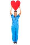 拿着心脏的医生 免版税图库摄影