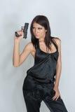 拿着性感的妇女的枪 免版税图库摄影