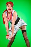 拿着性感的风妇女的盛开的礼服 免版税库存图片
