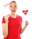 拿着情人节心脏的妇女 库存图片