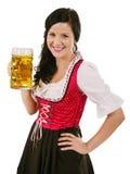 拿着慕尼黑啤酒节啤酒的微笑的妇女 库存图片