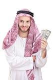 拿着我们的阿拉伯生意人美元新 免版税库存照片