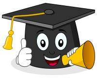 拿着扩音机的逗人喜爱的毕业帽子 免版税图库摄影