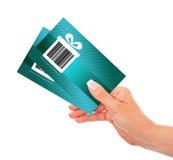 拿着折扣优惠券的手被隔绝在白色 库存照片