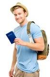 拿着护照白色背景的愉快的年轻旅游人 库存图片