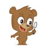 拿着放大镜的熊 免版税库存图片