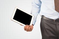 拿着数字式片剂个人计算机的商人 免版税库存照片