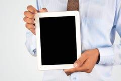 拿着数字式片剂个人计算机的商人 图库摄影