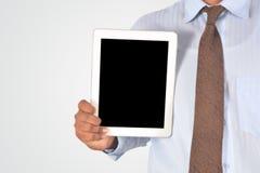 拿着数字式片剂个人计算机的商人 库存图片