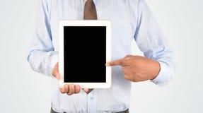 拿着数字式片剂个人计算机,被隔绝的非常professiona的商人 库存图片