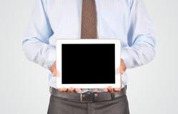 拿着数字式片剂个人计算机,被隔绝的非常professiona的商人 免版税库存照片