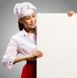 拿着文本的女性主厨一张海报 库存照片