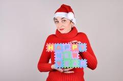 拿着新年快乐标志的妇女 库存图片
