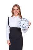 拿着时钟和查看照相机的妇女 免版税库存照片