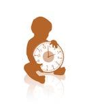 拿着时钟的小婴孩 免版税图库摄影
