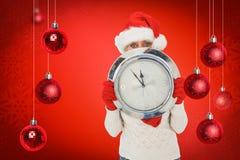 拿着时钟的欢乐的妇女的综合图象 库存图片