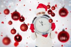 拿着时钟的欢乐的妇女的综合图象 免版税库存照片