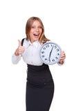 拿着时钟的高兴的女实业家 免版税库存图片